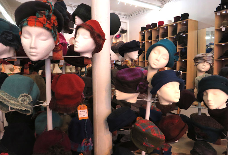 A large number of hats in many styles and colours