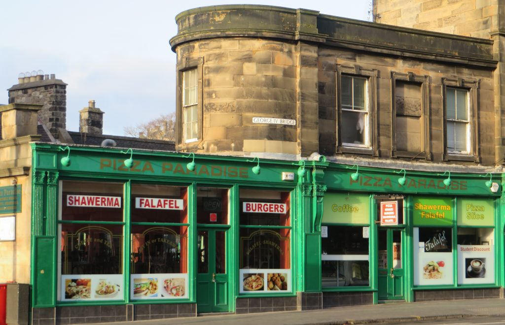 Victorian shopfronts, wood below with a rounded stone building above