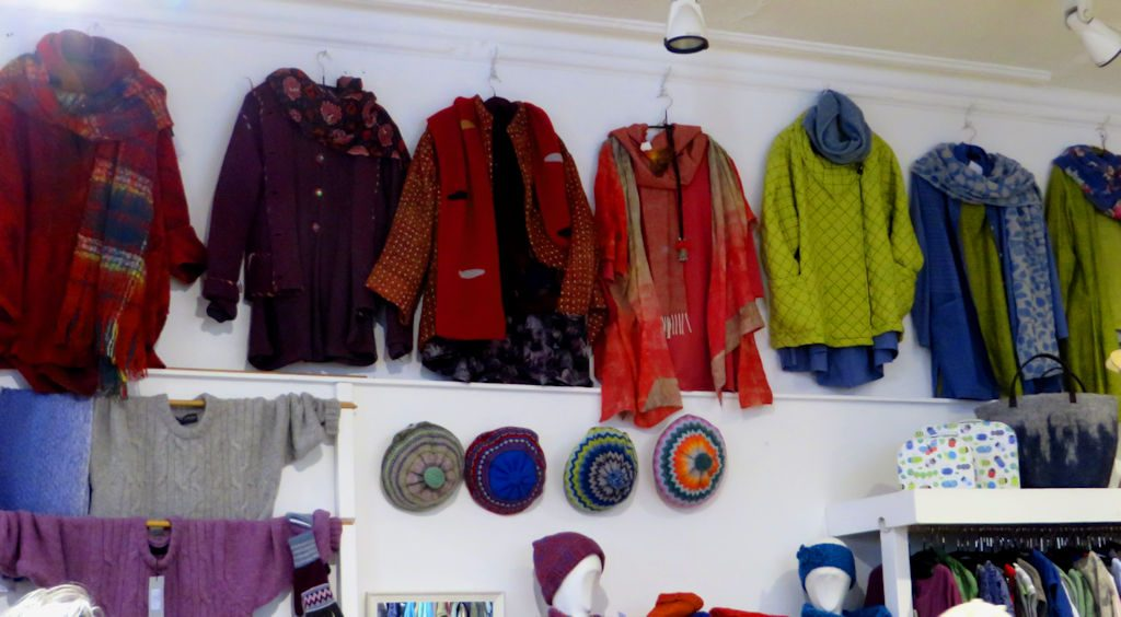 Jackets of many colours hanging on a wall