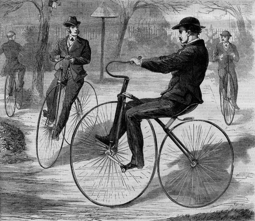 Engraving of men in Victorian clothes riding early bicycles