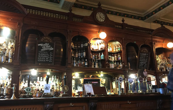 A Victorian period carved wooden bar back