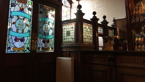 A tiny Victorian bar with stained glass screens