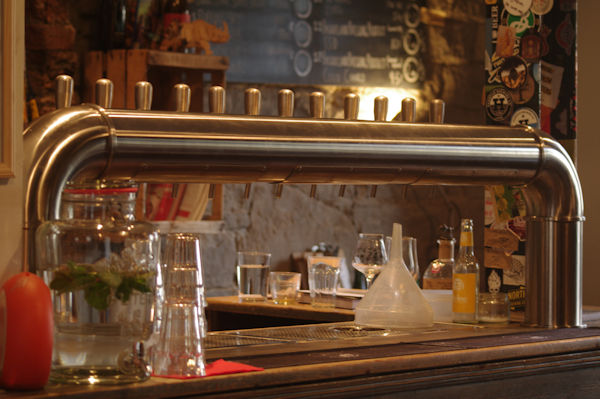A brass bar fitting with twelve serving taps