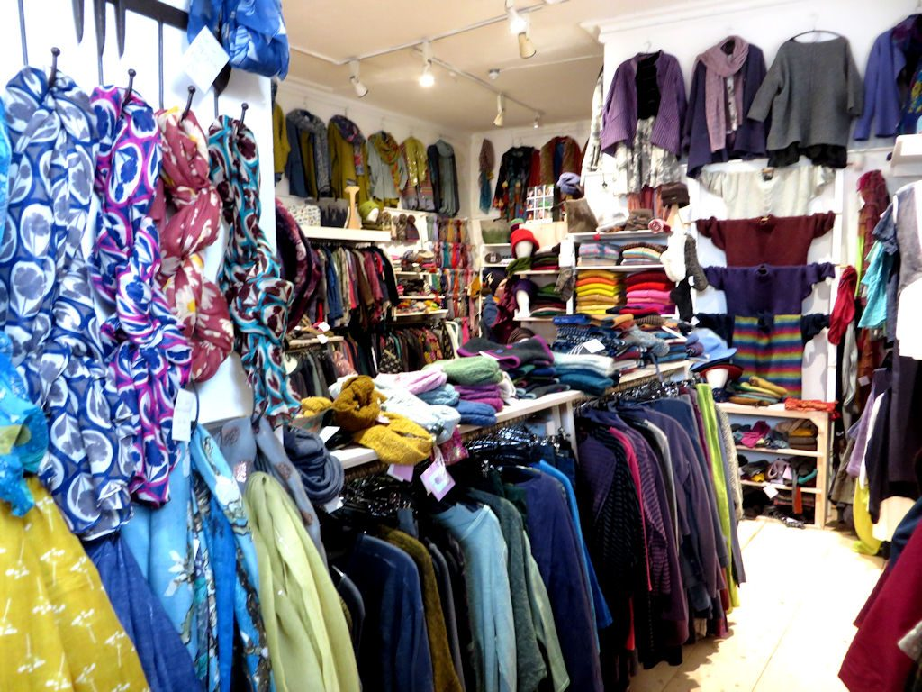 Shop interior with racks of brightly coloured woolen clothes